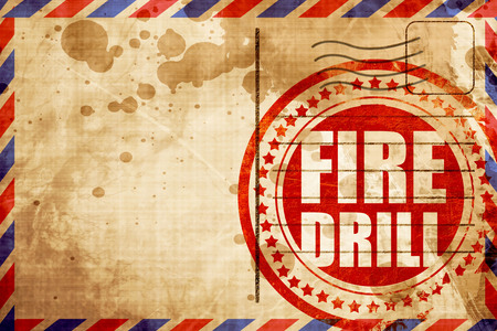 rehearse: fire drill, red grunge stamp on an airmail background