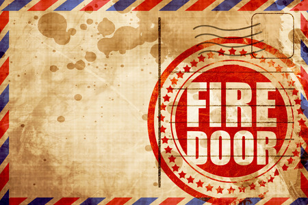 handle bars: fire door, red grunge stamp on an airmail background Stock Photo