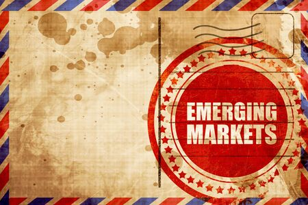 emerging markets: emerging markets, red grunge stamp on an airmail background