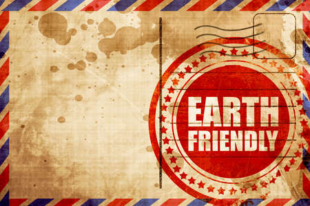earth friendly: earth friendly, red grunge stamp on an airmail background