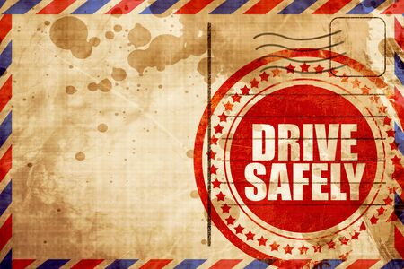 drive safely: drive safely, red grunge stamp on an airmail background
