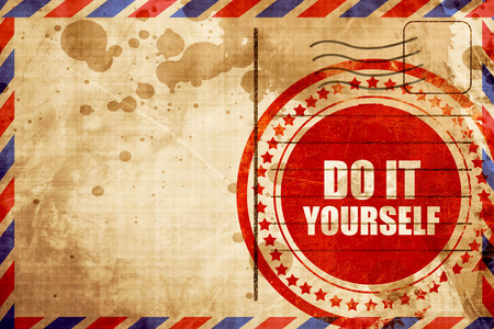 do it yourself: do it yourself, red grunge stamp on an airmail background