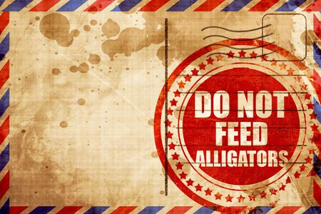 alligators: do not feed alligators, red grunge stamp on an airmail background