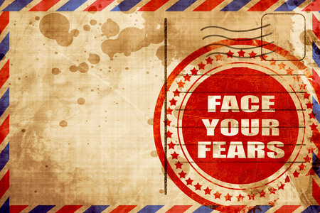 unafraid: face your fears, red grunge stamp on an airmail background