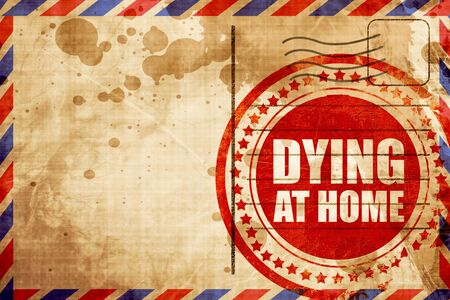 dying: dying at home, red grunge stamp on an airmail background Stock Photo
