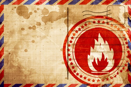 flammable: Flammable hazard sign with yellow and black colors, red grunge stamp on an airmail background