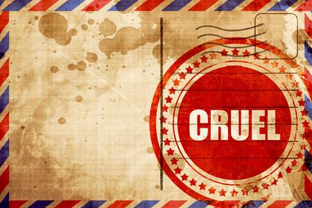 cruel: cruel, red grunge stamp on an airmail background Stock Photo
