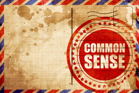 common sense: common sense, red grunge stamp on an airmail background