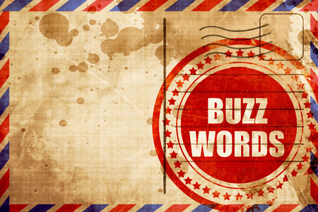 buzzword: buzzword, red grunge stamp on an airmail background Stock Photo
