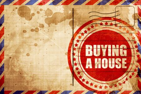 buying a house: buying a house, red grunge stamp on an airmail background