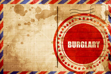 felonious: burglary, red grunge stamp on an airmail background