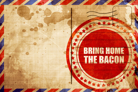 bring: bring home the bacon, red grunge stamp on an airmail background Stock Photo