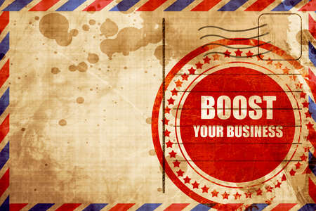 airmail stamp: boost your business, red grunge stamp on an airmail background Stock Photo