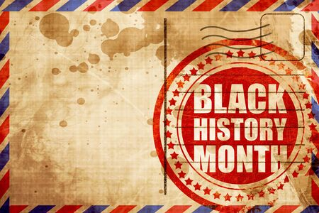 canvass: black history month, red grunge stamp on an airmail background