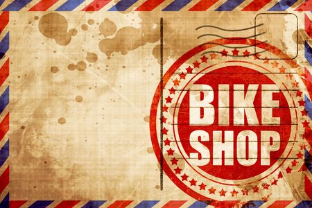 business service: bike shop, red grunge stamp on an airmail background Stock Photo