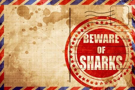 sighting: Beware of sharks sign with some smooth lines, red grunge stamp on an airmail background