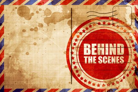 behind the scenes: behind the scenes, red grunge stamp on an airmail background Stock Photo