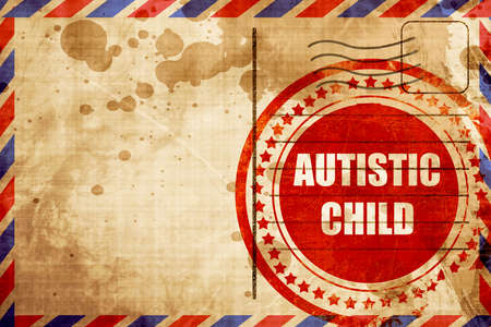 autistic: Autistic child sign with orange and black colors, red grunge stamp on an airmail background Stock Photo