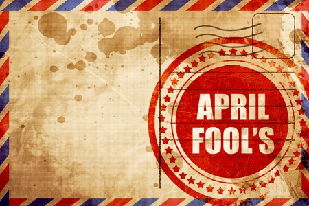 hoax: april fools, red grunge stamp on an airmail background