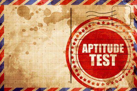 aptitude: aptitude test, red grunge stamp on an airmail background Stock Photo