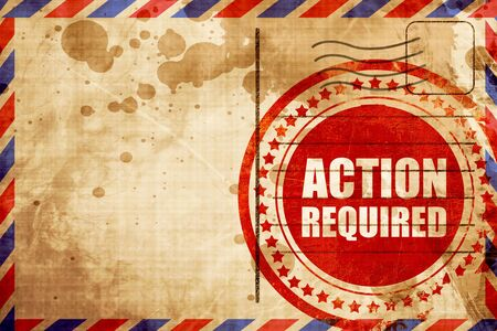 required: action required, red grunge stamp on an airmail background