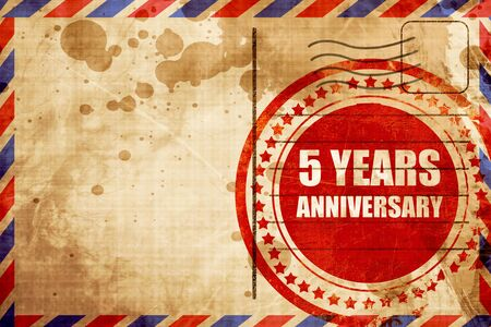 airmail stamp: 5 years anniversary, red grunge stamp on an airmail background Stock Photo