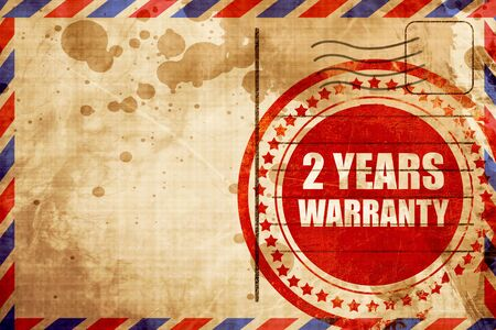 2 years: 2 years warranty, red grunge stamp on an airmail background