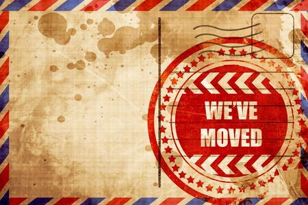 We've moved sign with some soft smooth lines, red grunge stamp on an airmail background