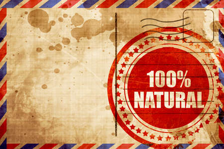 airmail stamp: 100% natural, red grunge stamp on an airmail background