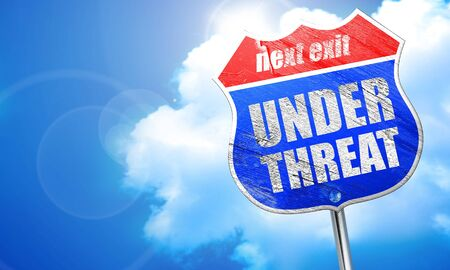 threat: under threat, 3D rendering, blue street sign Stock Photo