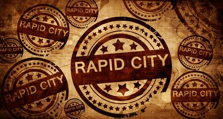 stamped: rapid city, vintage stamp on paper background Stock Photo