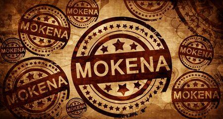 stamped: mokena, vintage stamp on paper background