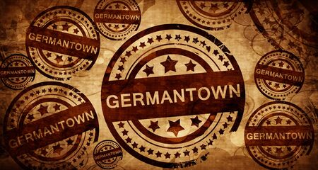 stamped: germantown, vintage stamp on paper background Stock Photo