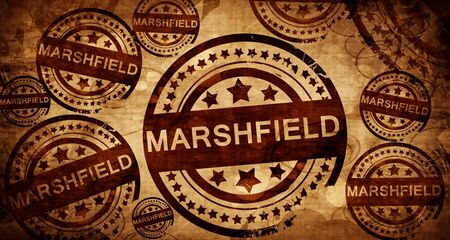 stamped: marshfield, vintage stamp on paper background Stock Photo