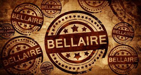 stamped: bellaire, vintage stamp on paper background