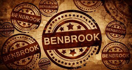 stamped: benbrook, vintage stamp on paper background Stock Photo