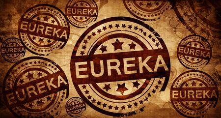 stamped: eureka, vintage stamp on paper background Stock Photo