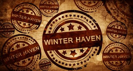 stamped: winter haven, vintage stamp on paper background Stock Photo