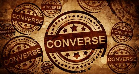 converse: converse, vintage stamp on paper background