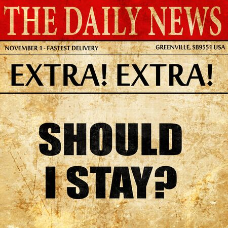 should i stay, newspaper article text Stock Photo