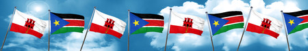 gibraltar flag with South Sudan flag, 3D rendering