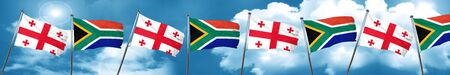 georgian: Georgia flag with South Africa flag, 3D rendering