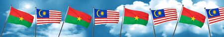 Burkina Faso flag with Malaysia flag, 3D rendering