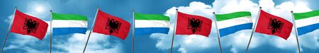 Albania flag with Sierra Leone flag, 3D rendering