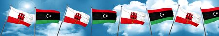 gibraltar flag with Libya flag, 3D rendering