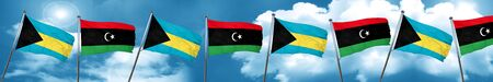 Bahamas flag with Libya flag, 3D rendering