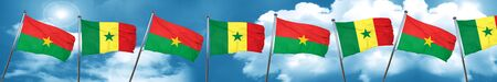 Burkina Faso flag with Senegal flag, 3D rendering