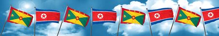 Grenada flag with North Korea flag, 3D rendering Stock Photo