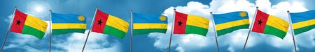 Guinea bissau flag with rwanda flag, 3D rendering