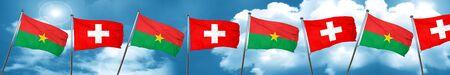 Burkina Faso flag with Switzerland flag, 3D rendering